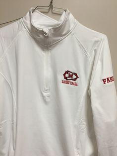Emb left chest logo for women's basketball on 1/4 zip thumbs hurt with name on sleeve