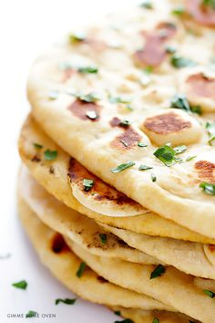 Learn how to make homemade naan (Indian flatbread) with this simple and delicious recipe! | gimmesomeoven.com
