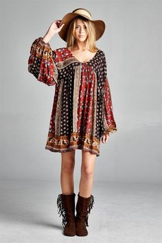 A long sleeve loose fit tunic with a flowy flare to it. Model is wearing size small.  100% Rayon Hand Wash Cold Wash Imported  Size Fits: Small: 4-6 ; Medium 6-8; Large 8-10 1XL 12-14; 2XL 16-18; 3XL 20-22