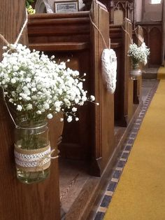 Gorgeous hessian and lace covered jam jars filled with gyp #gyp #weddingflowers