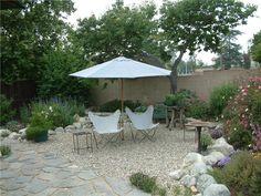 gravel patio with rock border