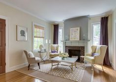 5-4-symmetrical-decor-symmetry-in-interior-design-traditional-style-living-room-interior-design-light-gray-walls-brick-fireplace-coffee-table-three-windows-arm-chairs-with-ears