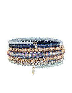 This eye-catching wraparound bracelet is decorated with an assortment of sparkling and cut-out metal beads.