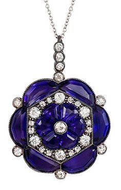 An Edwardian amethyst and diamond pendant of flower cluster design in sterling silver and gold, on platinum chain.