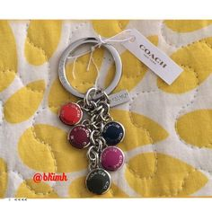 🌞 HP 🌞Coach 5 Button Key Ring 🌞HOST PICK 🌞 Coach 5 button key ring with coach tag. Buttons are different color and this is in silver tone. Key ring has Coach on the side with the Coach tag. A true beauty Coach Accessories