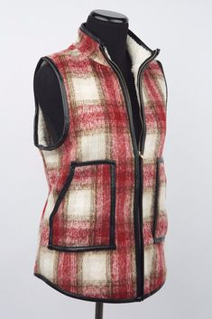 Layer up in the cozy Stephanie Red Plaid Vest. This outerwear staple zips from hem to chin, keeping you snuggled up and warm. With a faux leather trim, stay edgy and on trend. Rock this modern classic when you need an extra layer of warmth and style!