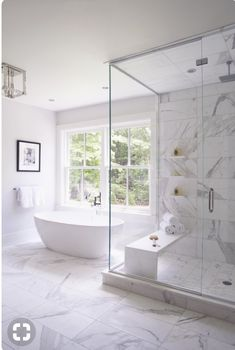 Amazing Bathrooms with Stunning Details white bathroom design with white vanity and white marble quartz counter and bathroom mirror with bathroom sconce and tile floor and subway tile shower Modern Master Bathroom, Modern Bathroom Design, Bathroom Interior Design, Master Bathrooms, Minimalist Bathroom, Small Bathrooms, Modern Design, White Marble Bathrooms, White Master Bathroom