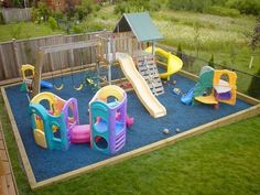 Kids will have a great time playing on this backyard playground with blue rubber mulch. #playgrounds #slides #backyard #kids #fun #rubbermulch #RoosterRubber