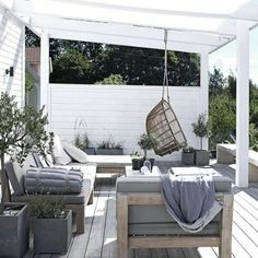 unfinished wood deck with pergola and unfinished wood lounge furniture with grey cushions Backyard Playhouse, Backyard Pergola, Pergola Plans, Pergola Ideas, Outdoor Spaces, Outdoor Living, Outdoor Decor, Outdoor Shower Fixtures, Pergola Attached To House