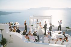 You just can't beat this breathtaking view in Santorini, Greece! An intimate, traditional wedding on a terrace. {Anna Roussos Photography}