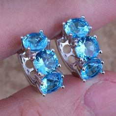 BEAUTIFUL 9.25 SILVER BLUE TOPAZ HUGGIE EARRINGS BEAUTIFUL 9.25. STERLING SILVER BLUE TOPAZ HUGGIE EARRINGS. BUNDLE AND SAVE BIG. NO PAYPAL.NO LOW BALLERS. I AM A POSH COMPLIANT CLOSET. Jewelry Earrings