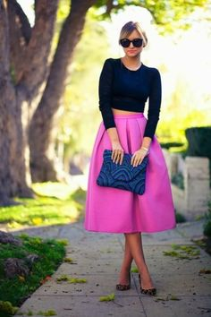 Colourful midi skirts with a black crop creates more interest than two full on pieces. It shows off the main detail being the skirt without being too busy. Tie with a contrasting coloured clutch and black heels