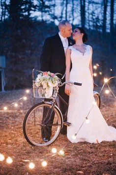 The bride & groom with our tandem bicycle.  Loving the flowers in the bike basket and the lights surrounding them!  *Paisley & Jade...Vintage & Eclectic Furniture Rentals for Events, Weddings & Photo Shoots*