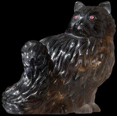 Faberge - A figure of a Persian cat : attributed to Karl Faberge, circa 1910, made of smoky quartz with elaborately and finely carved coat, 2 ruby eyes set in gold.