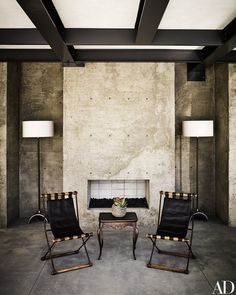 Sling chairs by Cleo Baldon join the pool pavilion's concrete fireplace | archdigest.com