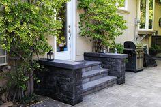 Custom masonry work around natural stone steps. Driveway Sealing, Driveway Repair, Creative Landscape, Landscape Design, Retaining Wall Repair, Richmond Hill Ontario, Masonry Work, Professional Landscaping, Entrance Ways