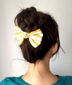11. Give a boring bun an update by placing a hair bow at the base of the bun.