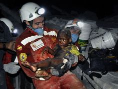 Carol Guzy for The Washington Post, Child being rescued from rubble after earthquake in Haiti, 2011 Pulitzer Prize Winner for Breaking News Photography