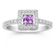 Princess Cut Lavender Sapphire and Diamond Ring $697    This compelling design features four princess-cut lavender sapphires, at approximately .15 carat TW. These vivid stones are accentuated with 26 round diamonds, at approximately .22 carat TW, that have been set into a quality 14 karat white gold band. The total gem weight is approximately .37 carat.