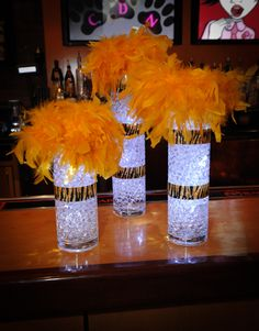Aqua gems resemble glass marbles and are beautiful additions to any centerpiece. We use different size vases and cylinders filled with aqua gems and LED lights and sit them on a mirror with crystal votive candles and crystal chips. African Party Theme, Cheetah Party, Leopard Birthday, Afro Chic, Animal Print Party, Sweet 16 Decorations, Lion King Baby Shower, Party Centerpieces, Sweet Sixteen Centerpieces