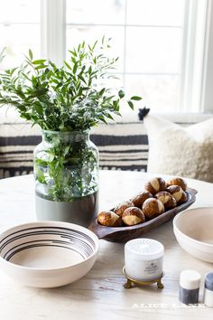This spring we are so excited to use Greenery—the Pantone Color of the Year—as some of our inspiration! We loved bringing the color in naturally with some pretty plants to brighten up the kitchen. How yummy does this counter space look with a touch of green? We're obsessed! Home Decorating Blog | Alice Lane Home Collection