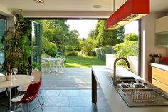 Narrow kitchen extension- love the accordion doors!