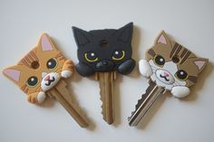 ♥ Cool Cat Stuff ♥ Cat key covers..... totally impractical and stupid but I am the sort of crazy cat lady that would consider it for a moment, or two. But NO i'm not doing it.