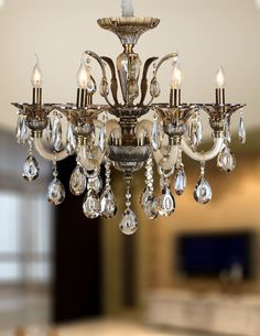 This stunning traditional look can only be achive by the Loretta family. Add a touch of elegance to your home decor with this lustrous chandelier.Crystal Quality Column and Glass Made Good Quality Arms and Bobeches with Hanging Precision Cut Droplets Chandelier Lighting, Chandeliers, Traditional Looks, Made Goods, Antique Brass, Eye Candy, Champagne, Ceiling Lights, Elegant