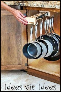 Awesome way to keep the cookware cupboards neat!