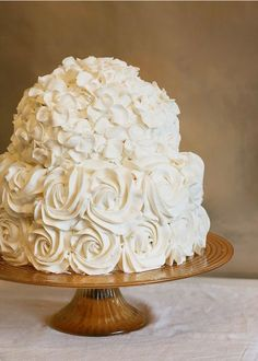 ivory wedding cake with the most beautiful sugar flowers I've ever seen