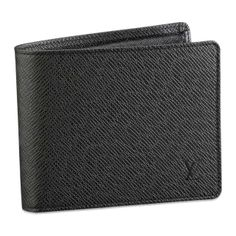 """Louis Vuitton Taiga Leather Florin Ardoise M31112    This Taiga leather Florin wallet,part of Louis Vuitton's celebrated men's collection,is compact and will easily slip into pants or jacket pocket.  Taiga leather discreetly stamped with the LV initials,grained calfskin lining; Four credit card slots; Bill slot.  4.9"""" x 3.9"""" x 1"""""""