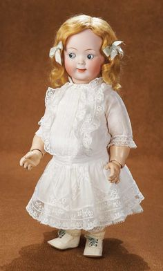 "Marks: 165 -9. Comments: Hertel and Schwab,1914,created under special commission for Strobel and Wilkin,which was celebrating its 50th anniversary (1865-1914) at this time; the doll was inspired by the popular Campbell Kid designs of Grace Drayton,and was marketed as ""Jubilee Doll"" in honor of the anniversary."