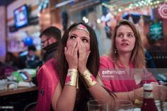 A Democratic Party supporter, dressed as the superhero 'Wonder Woman', reacts as they watch election results come in at the Democrats Abroad election night party at Marylebone Sports Bar and Grill, London, U.K., on Wednesday, Nov. 9, 2016. Donald Trump was elected the 45th president of the United States in a stunning repudiation of the political establishment that jolted financial markets and likely will reorder the nation's priorities and fundamentally alter America's relationship with the…