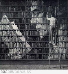 Beautiful painting of a man reading his books across the spines. Juniper Books could make the real thing.