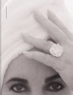 Elizabeth Taylor (and what looks like the Krupp diamond) photographed by Herb Ritts in Malibu, 1991.