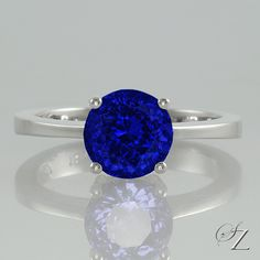Such a glorious shade of blue, this Tanzanite is utterly gorgeous. Set in the quintessential solitaire setting with four corner prongs and a delicate shank, keeping all the attention on that sensational Tanzanite. It's hard to beat a classic!