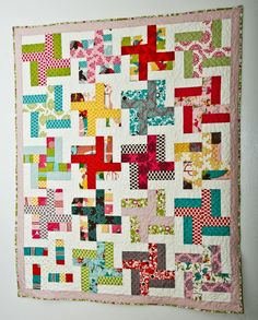 Lella Boutique's Dizzy Spell quilt. The pattern is perfect for beginners and can be made using fat quarters, a jelly roll, or a layer cake.
