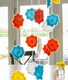 Celebration Garland Free Crochet Pattern in Red Heart Yarns - This sparkly variation of Scrubby yarn is perfect for party decorations or to make a child's room a happy place. Simply crochet the flower motifs, use a chain to join them together and hang as desired.