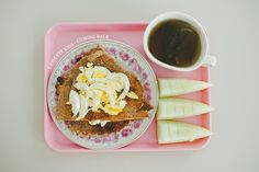 Whole grain spelt frying pan bread w sliced boiled egg, honey melon, tea