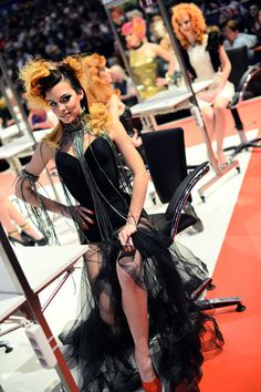 "Models styled by participants await judging during the contest ""Day style"" of the OMC Hairworld World Cup on May 4, 2014 in Frankfurt am Mai..."