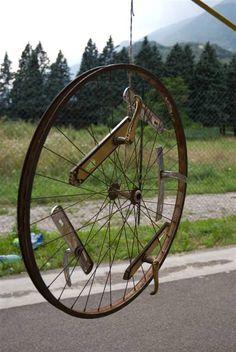 #Bike, #Clothes, #Door, #Hanger, #Wheels Clothes hanger made out of bicycle wheel and door handles.