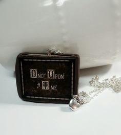 Inspired by Henry's book from the beloved show Once upon a time . * handmade polymer clay necklace with charm. * on 22 inch long chain with lobster clasp