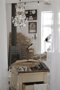 Little wood burning stove and brick wall for the mudroom