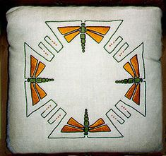 Arts and Crafts embroidered geometric butterfly pillow.