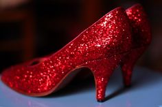 The Wizard of Oz was my favorite movie as a child. I would've killed for a pair of these back then.
