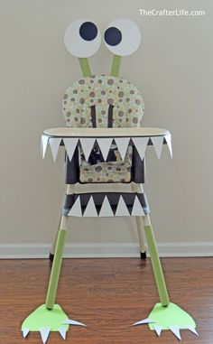 I planned on decorating my son's high chair for his first birthday since that is where he would be performing the most exciting part of a one-year-old's birthday – eating the cake! I was going to make a pennant banner to hang from the high chair tray when I realized that I could make the pennant banner look like monster teeth by making each triangular flag white. And then I figured I may as well dress the entire high chair up like a monster because, well, I'm crazy!