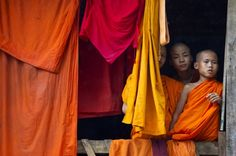 Burmese novice monks look out from a window at the Thirisaridar monastery inside the Mae La refugee camp. Paula Bronstein / Getty Images