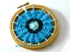 Circular weaving on embroidery hoop #7 by gingerbread_snowflakes, via Flickr