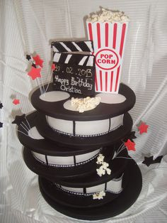 movie themed party....can maybe paint old ribbon spools to make the film reels.