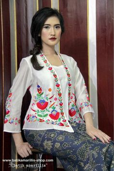 batik amarillis's miss popon Batik Amarillis webstore :www.batikamarillis-shop.com Lovely Kebaya encim inspired and designed which features 3D Hungarian stumblework embroidery style, wear it over Miss Popon Camisole and The Warrior pants or any kind of bottoms will do nicely with this lovely Miss Popon.